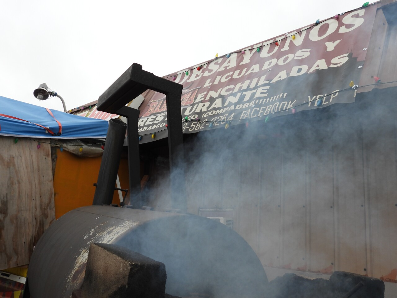 Meat is smoked in front of GG's Barbacoa Cafe.JPG