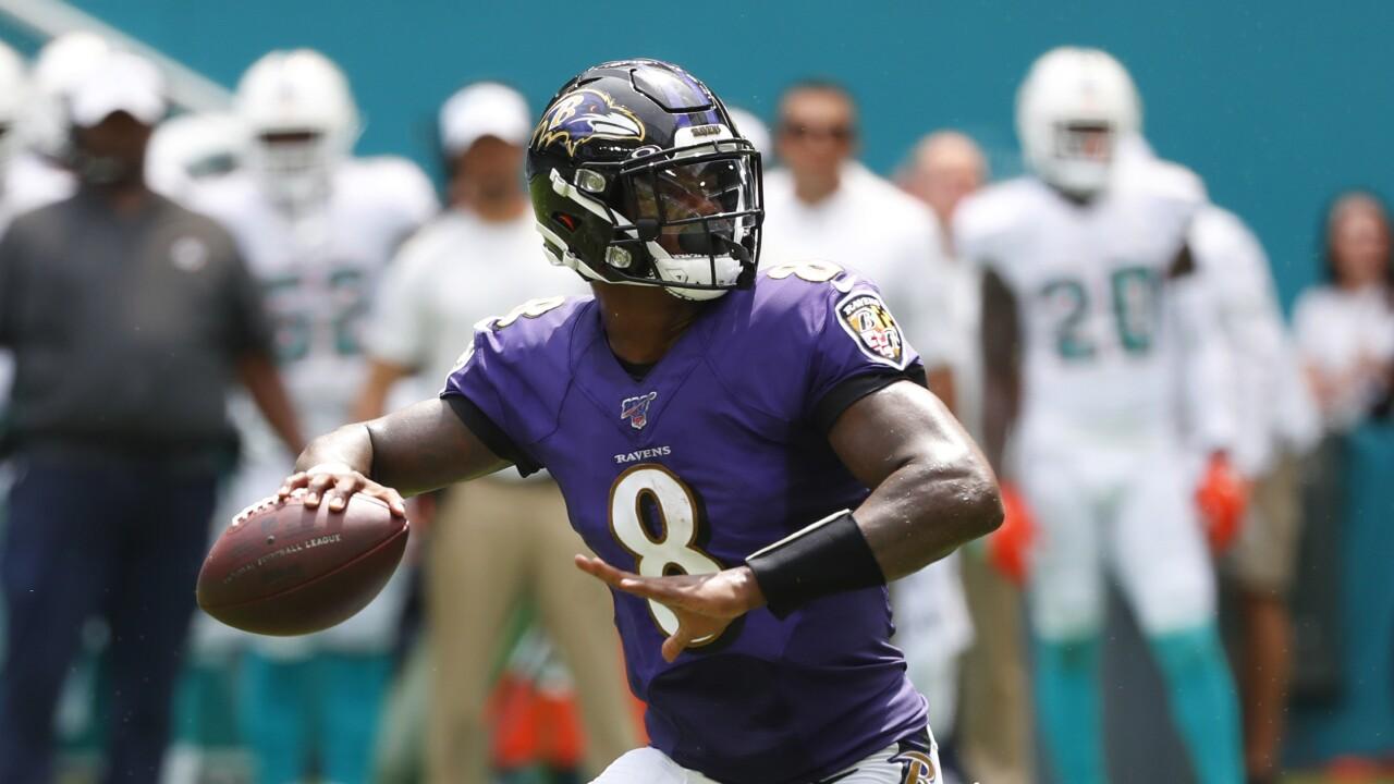 Baltimore Ravens QB Lamar Jackson passes at Miami Dolphins in 2019