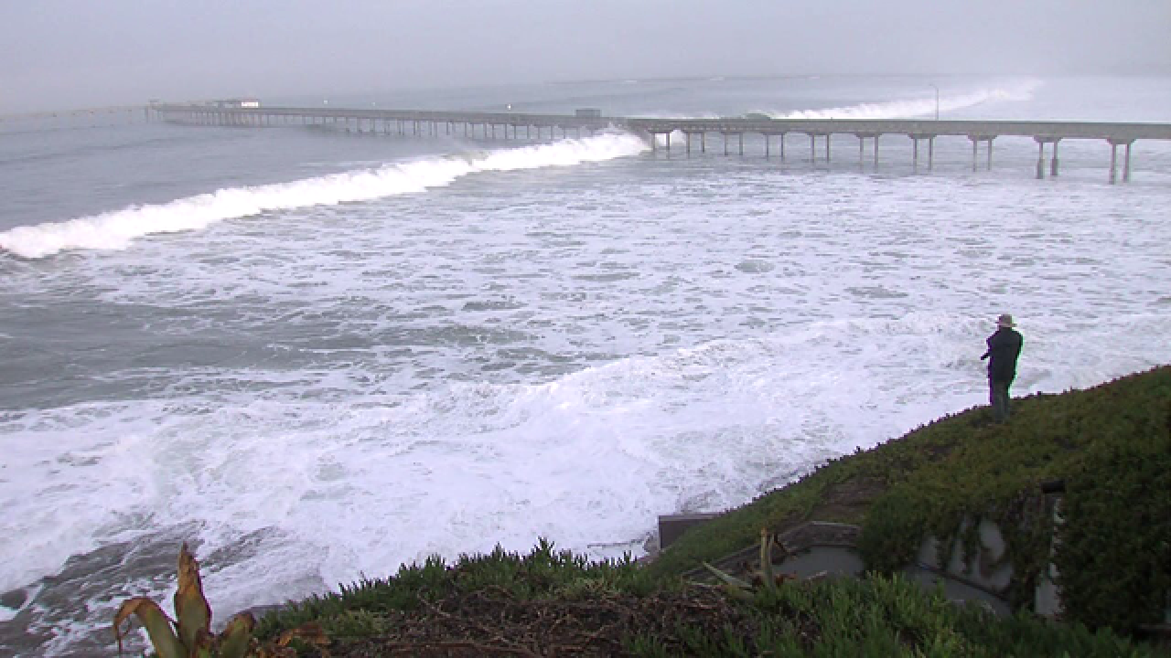 High surf pounding beaches, closes OB Pier