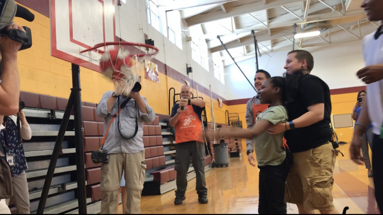 Hampton middle schooler with cerebral palsy shoots hoops on specializedbasket