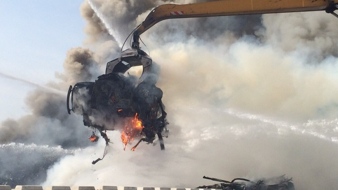 Smoky junk yard fire burning in S. Batlimore