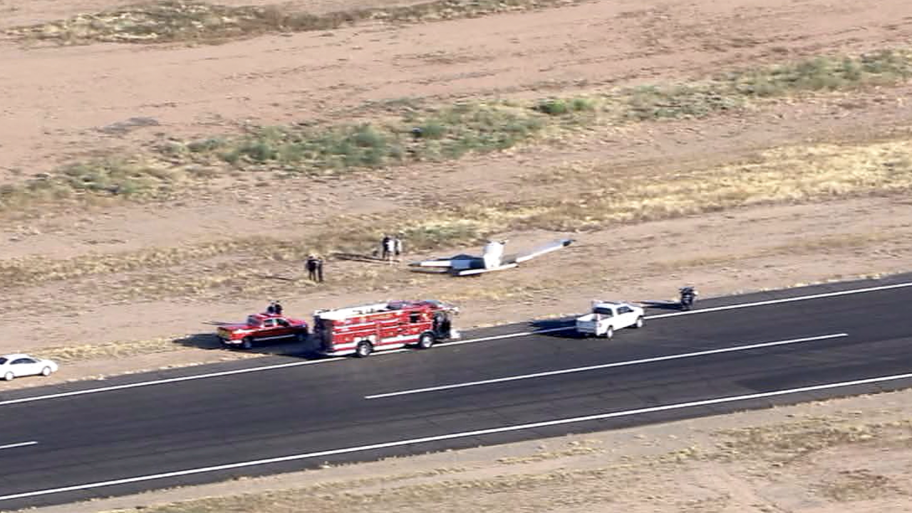 Officials in Arizona say a helicopter crashed and burned after the copter collided in midair over suburban Phoenix with a single-engine plane that landed safely at an airport.