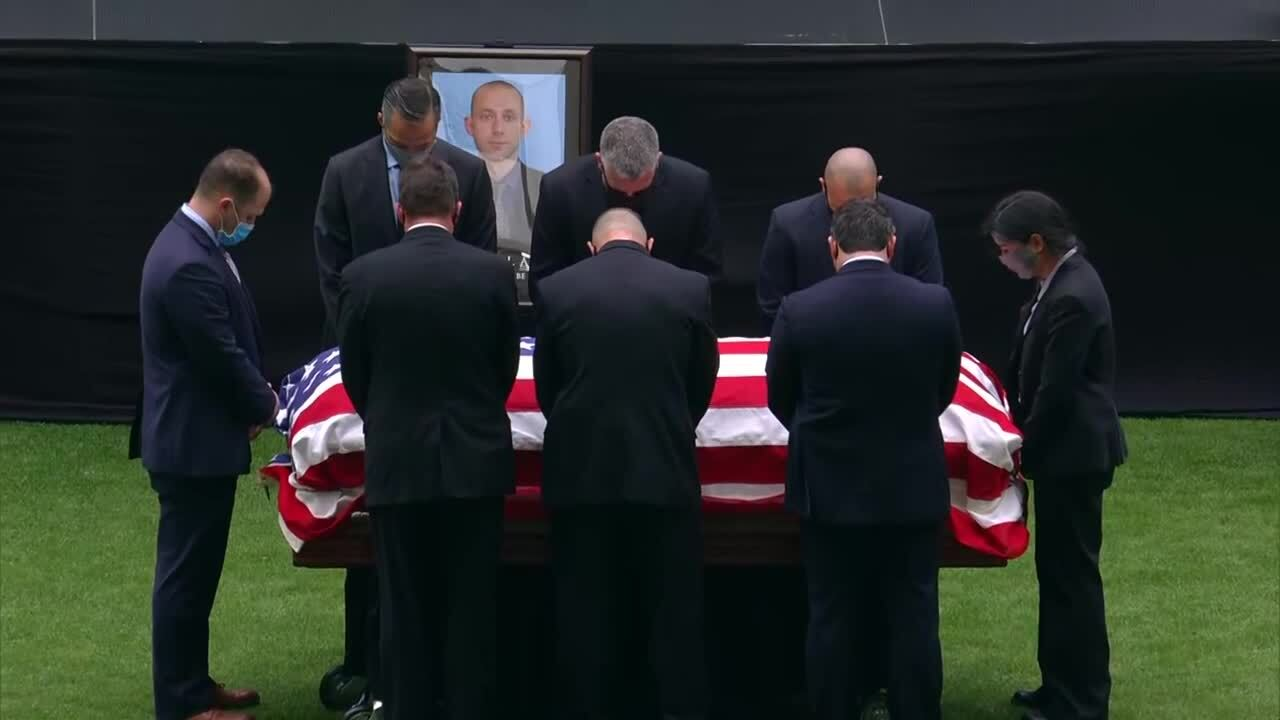 Pallbearers bow their heads while standing around casket of Daniel Alfin during memorial service at Hard Rock Stadium, Feb. 7, 2021