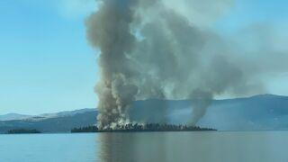 Wildfire burning on Bird Island in Flathead Lake