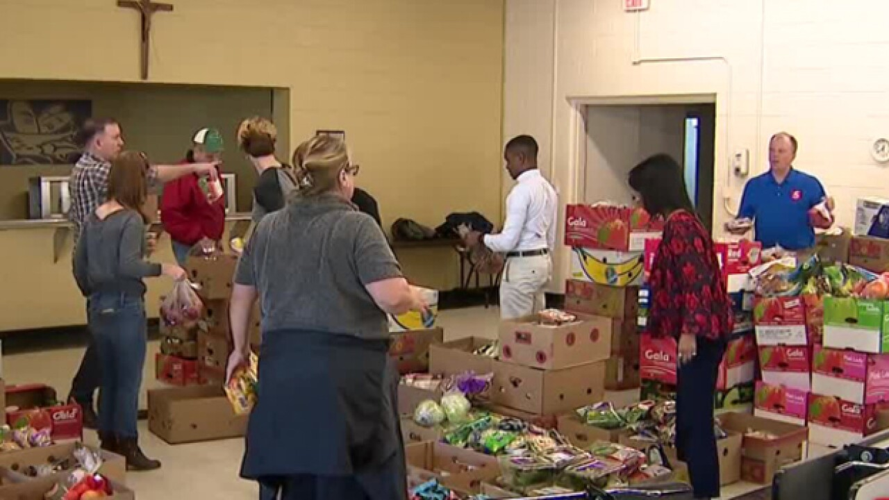 NC5 Team Members Volunteer At Food Bank