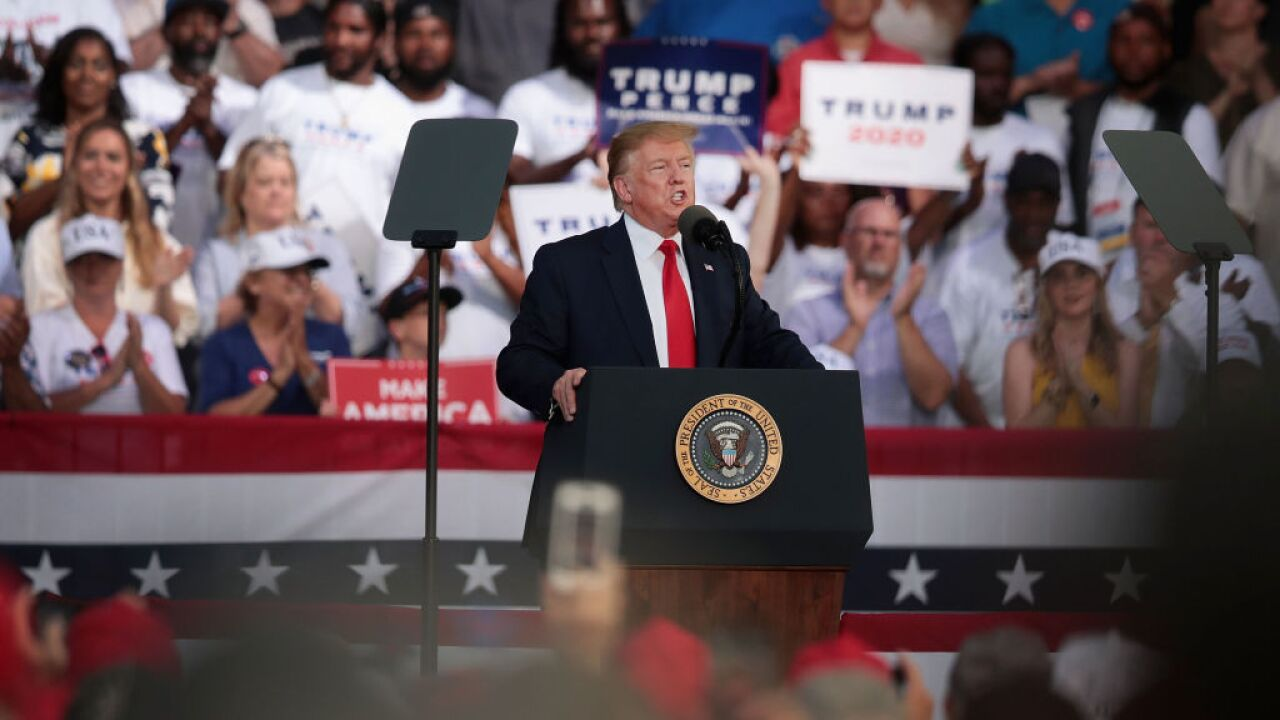 Trump jokes after rally attendee's suggestion to 'shoot' migrants at the border
