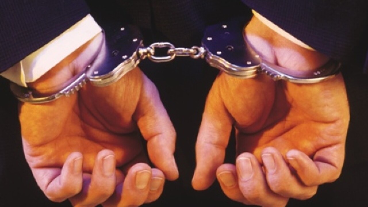 Hands put behind back with handcuffs on the wrists