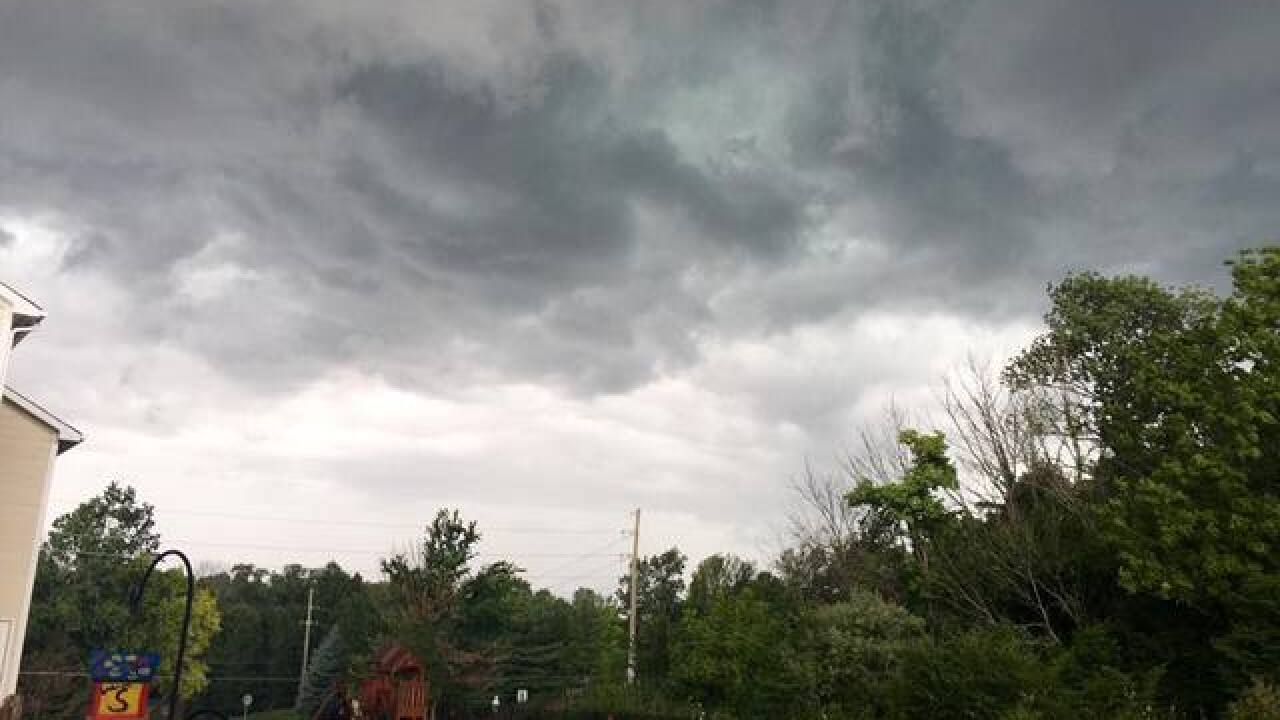 PHOTOS: Ominous skies and storm damage