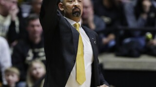 Wolverines win 5th straight at Purdue 71-63