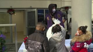 Lamar Jackson helps distribute toys to more than 150 families and children .jpg