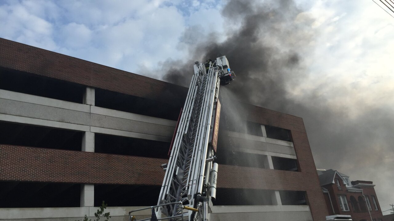 Newport News Fire Department responds to several cars on fire in parking garage