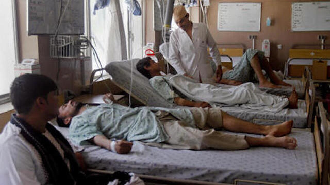 Afghan officials: Taliban attack buses