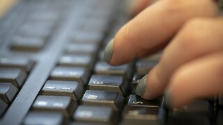 Computer typing woman work online hack