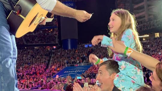 Garth Brooks honors girls' request at concert and sings 'People Loving People'