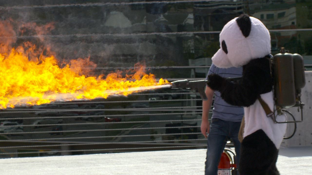 Costumed panda uses flamethrower in 'ribbon torching' ceremony