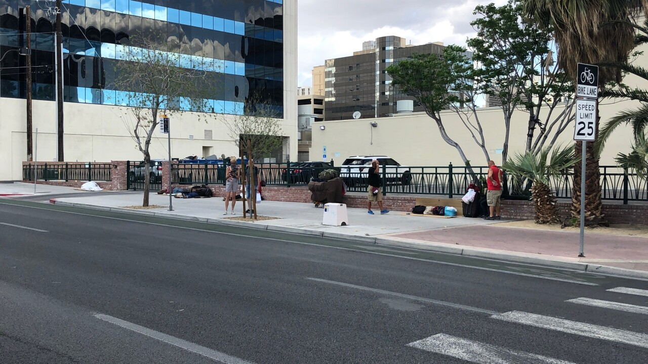 A Las Vegas law firm says they are inundated with homeless people after a recent park closure has forced them onto sidewalks and back alleys for their bathroom needs and sex acts