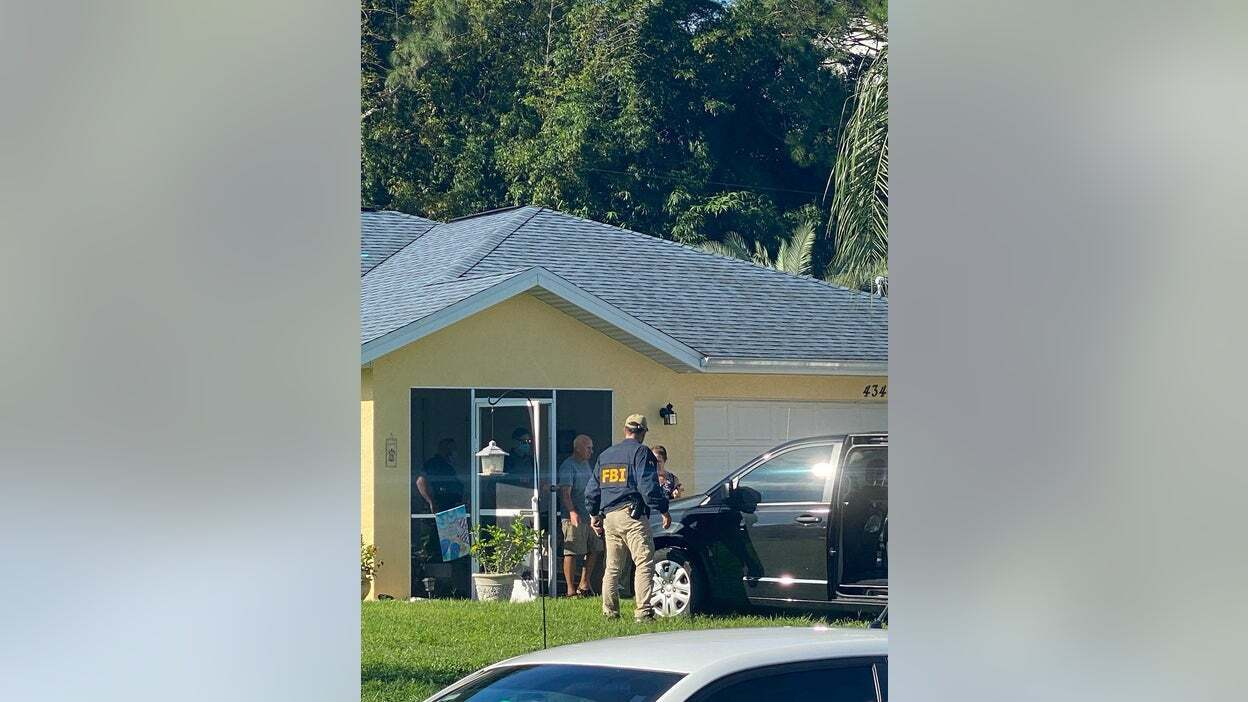 Chris Laundrie being led out of his house during execution of a search warrant September 20. (Fox News)