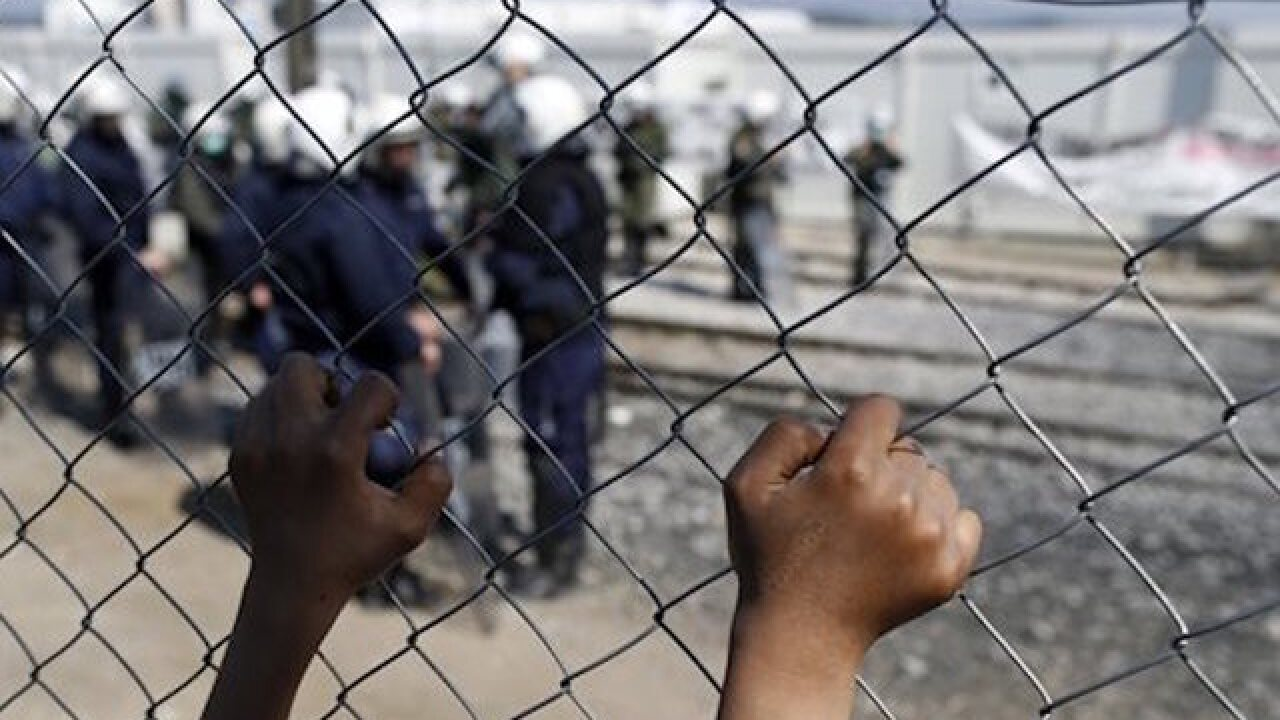 French police evacuate migrant camp
