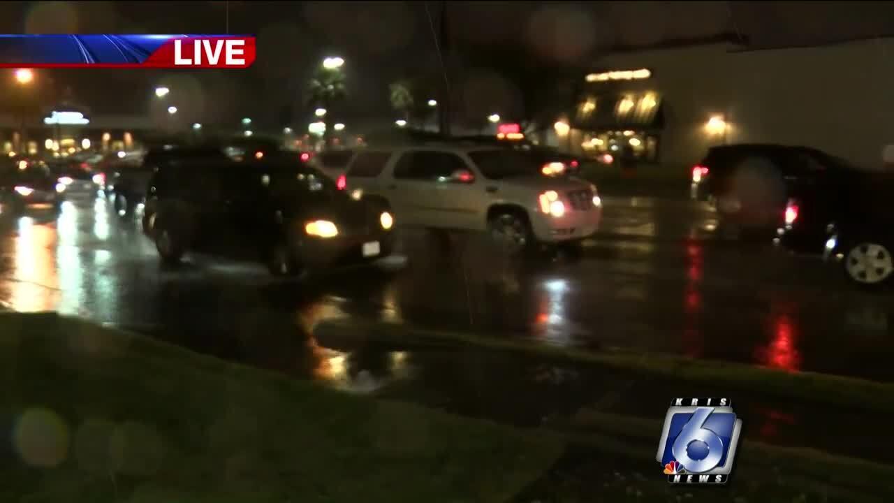 Traffic around a wet La Palmera Mall