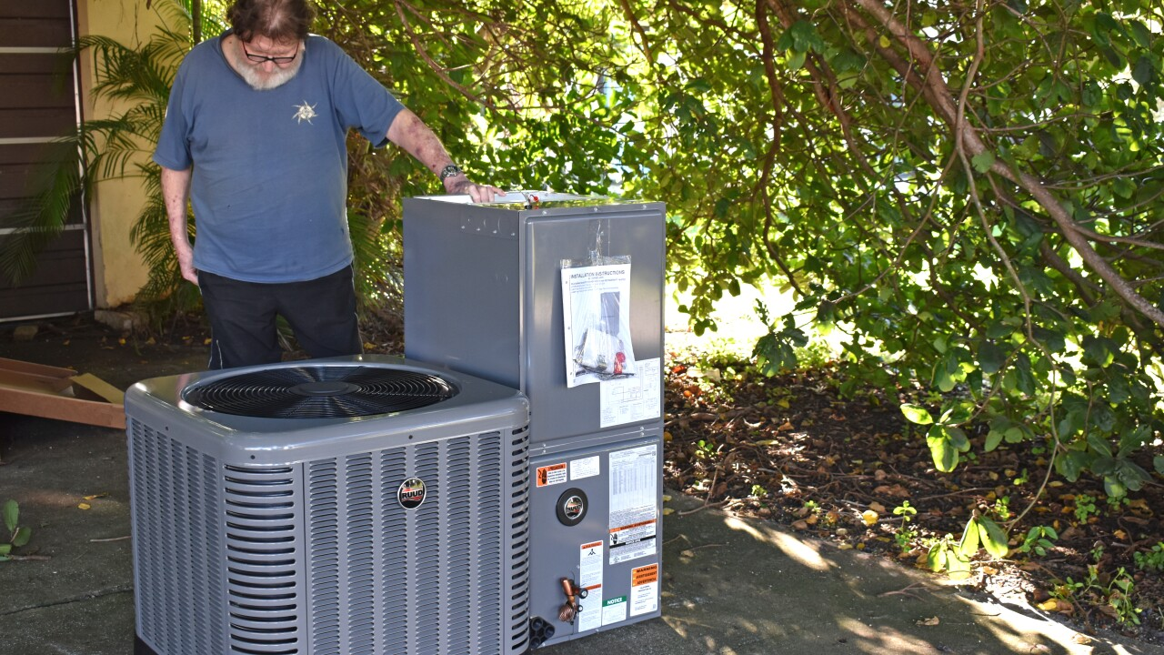 Photo 4 - Homeowner Jon Smith receives gift of AC unit after 15 years without AC.JPG