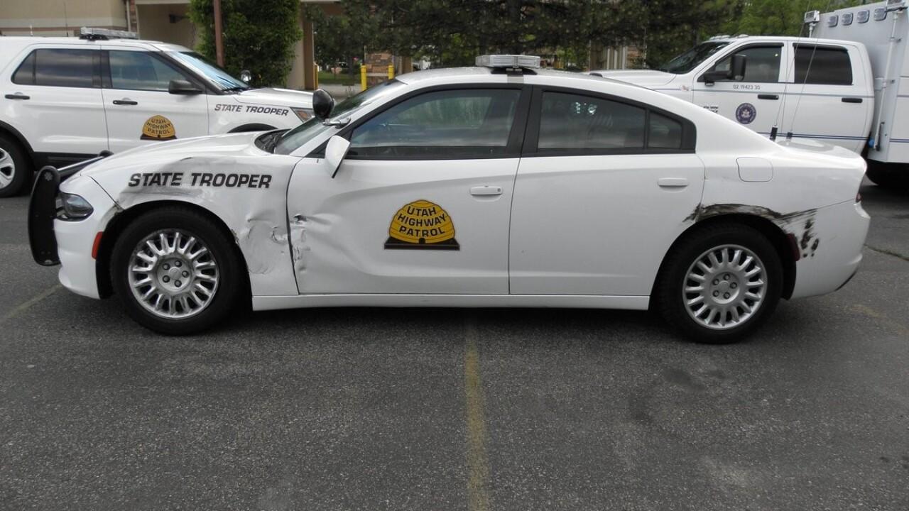 Patrol car hit by truck on I-15 as Utah trooper performed slow down due todebris