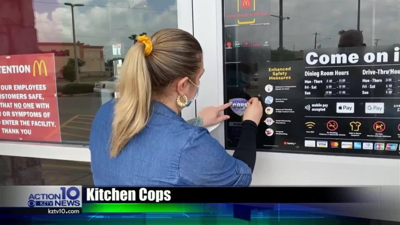 Krystal Gluth proudly displays her perfect Kitchen Cops sticker