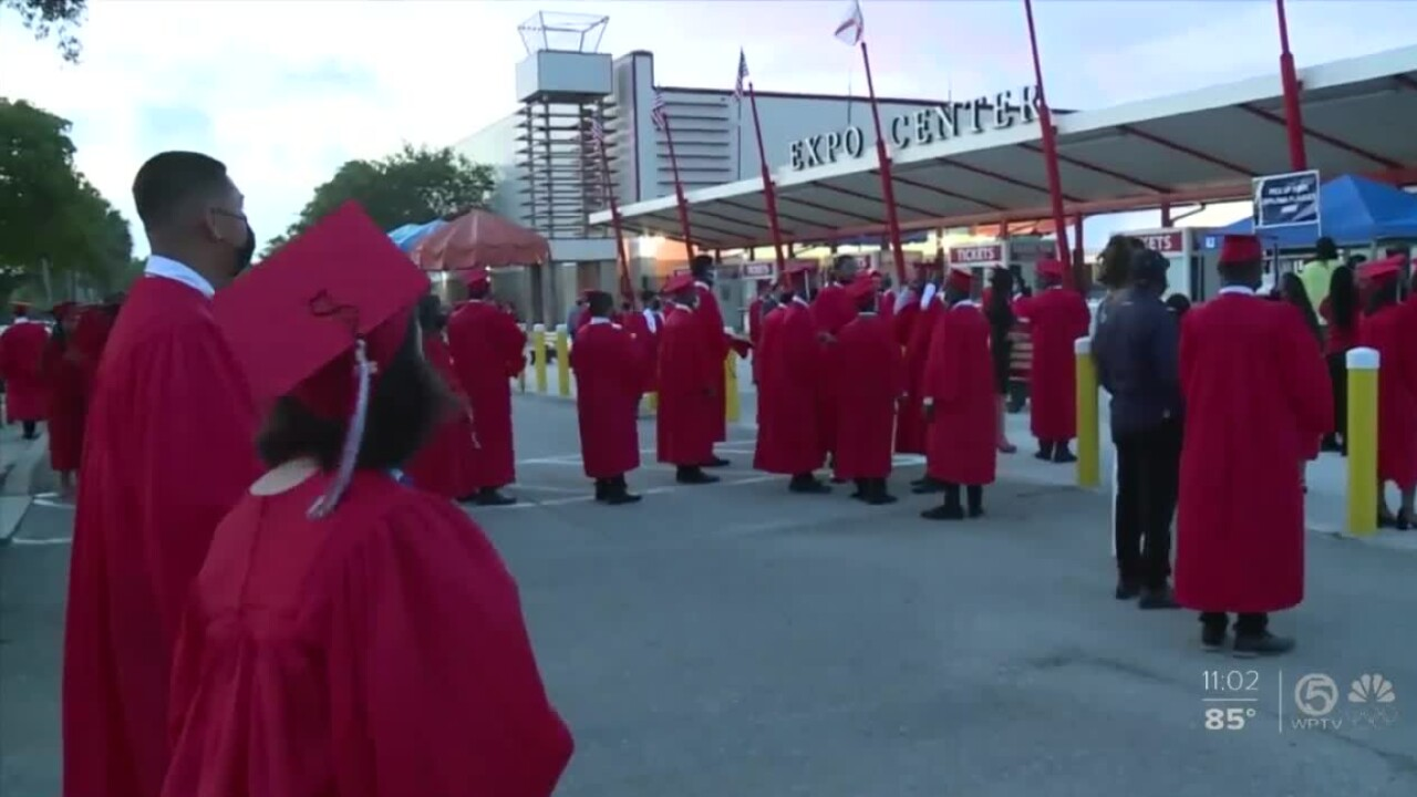 Students from Santaluces Community High School celebrate their in-person graduation at the Expo Center at the South Florida Fairgrounds on June 7, 2021.jpg