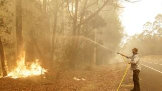 Australian crews race to contain blazes as damage bill soars