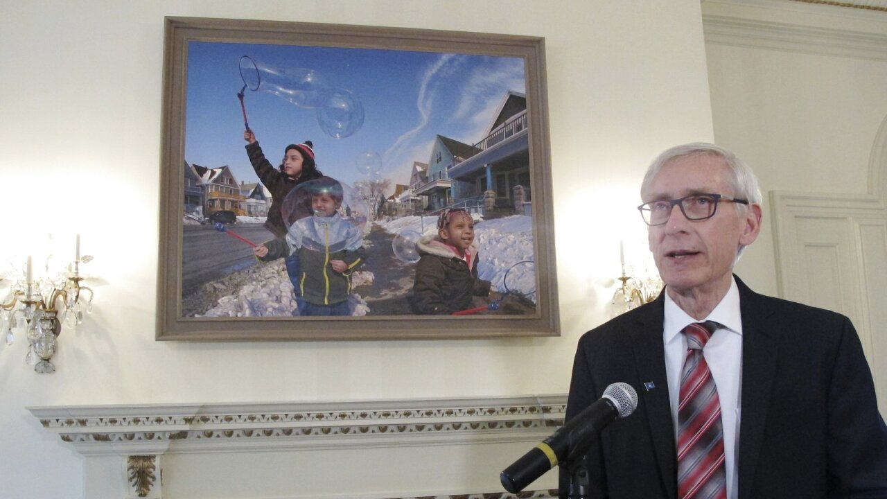 Gov. Tony Evers addresses media next to mural in Governor's mansion