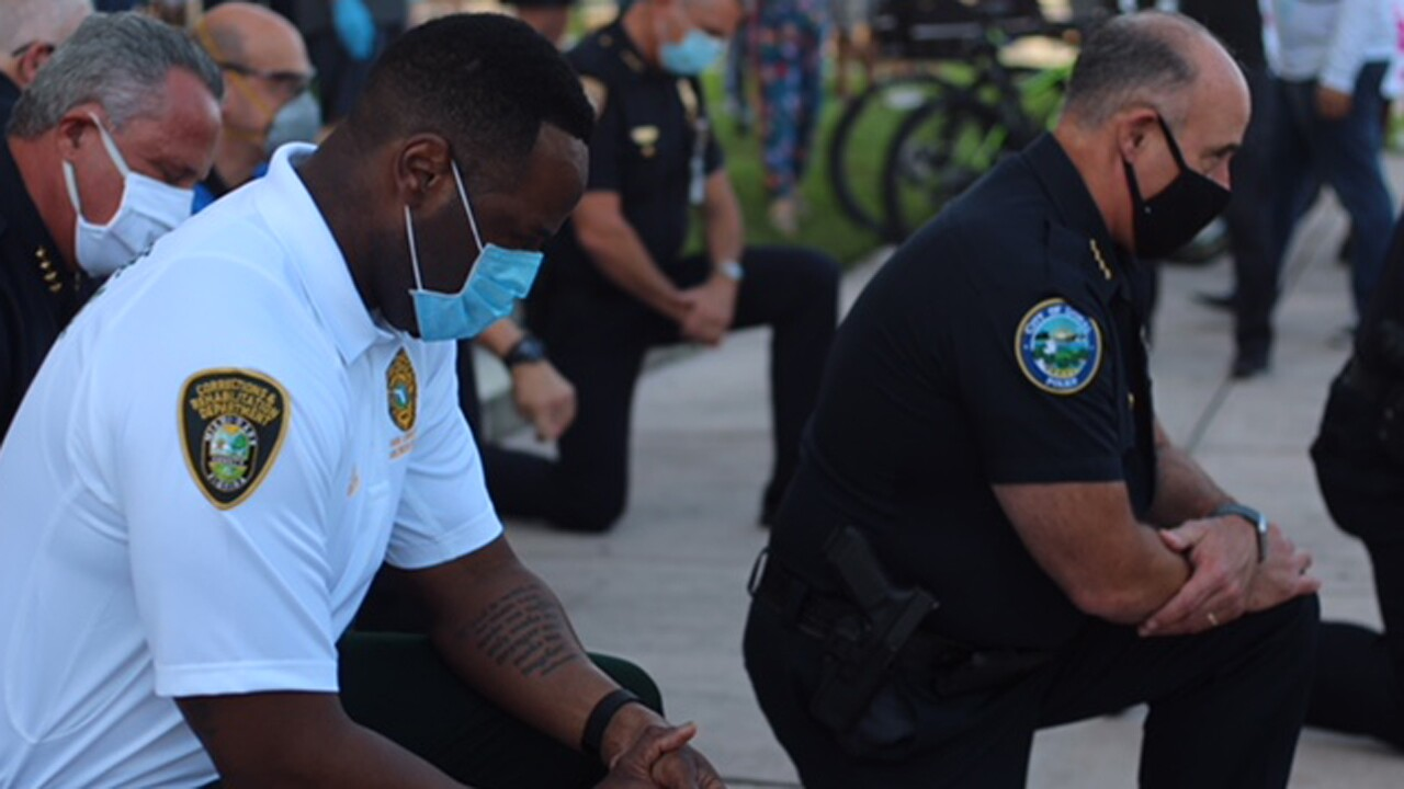 Police and law enforcement from multiple departments in Miami-Dade County attended a protest in Coral Gables, taking a knee in solidarity and prayer with the protesters.