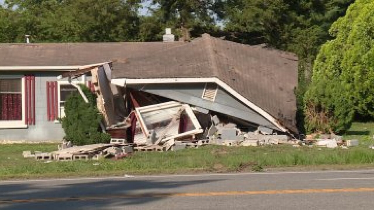 Truck slams into Virginia home with woman inside