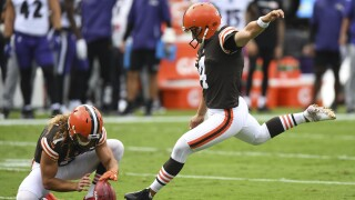 Browns Kicking Change Football