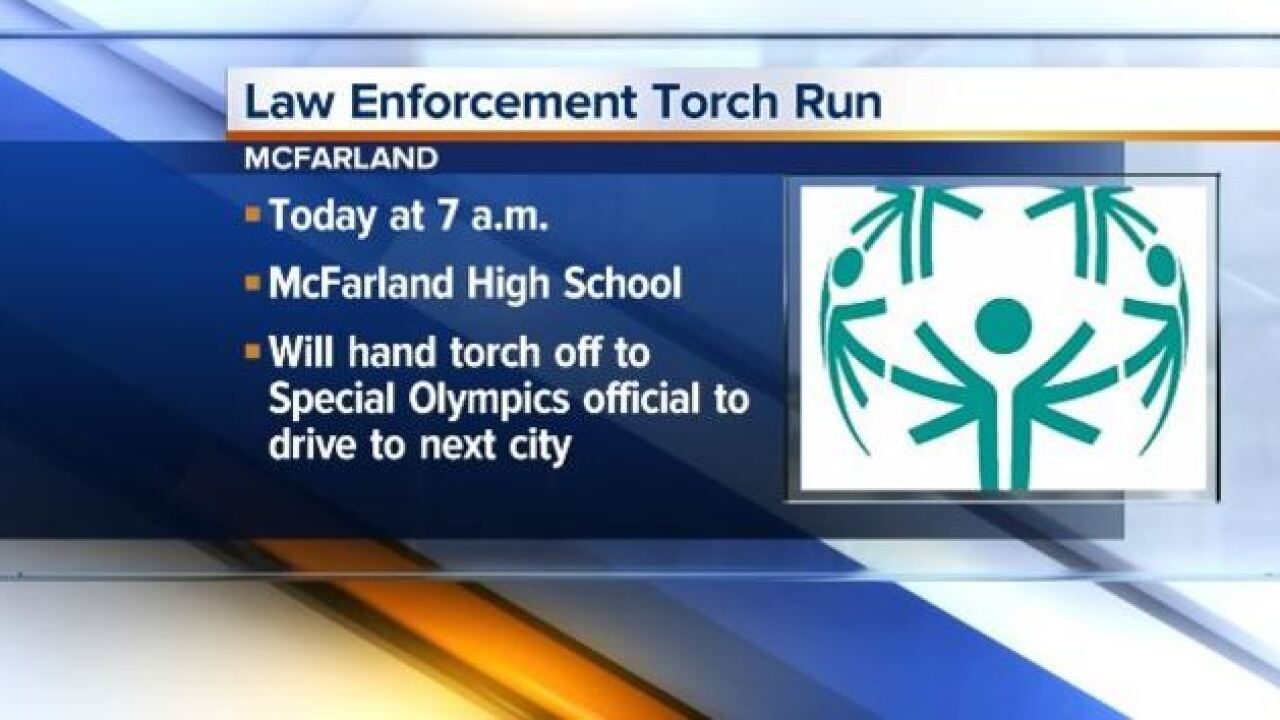 Law enforcement carry Special Olympics' torch