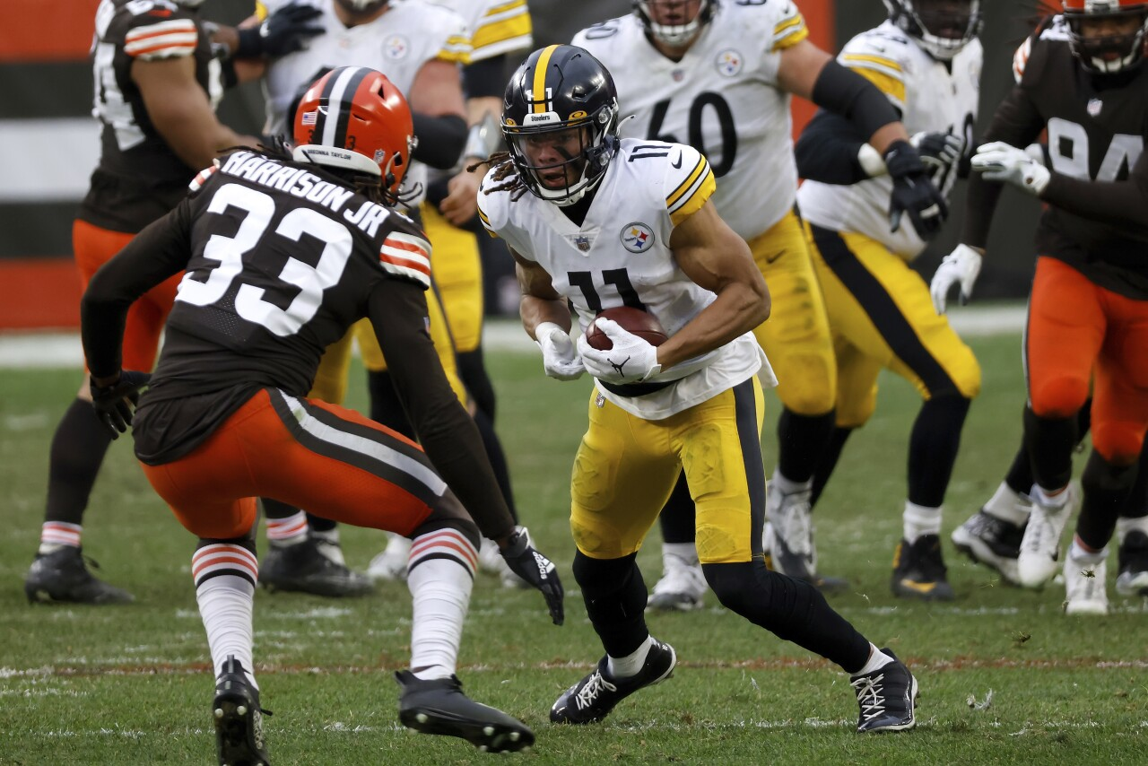 Pittsburgh Steelers receiver Chase Claypool tries to elude Cleveland Browns safety Ronnie Harrison in January 2021