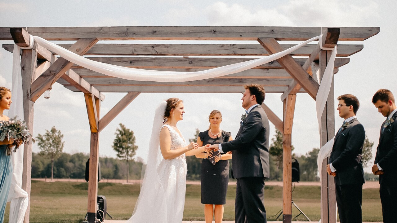 Wedding officiant Angel Bodenhamer marries Sarah Mueller of Carmel. Mueller has filed several complaints against the officiant.