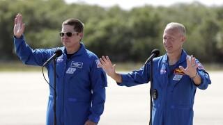 NASA astronauts Bob Behnken and Doug Hurley wave, May 20, 2020