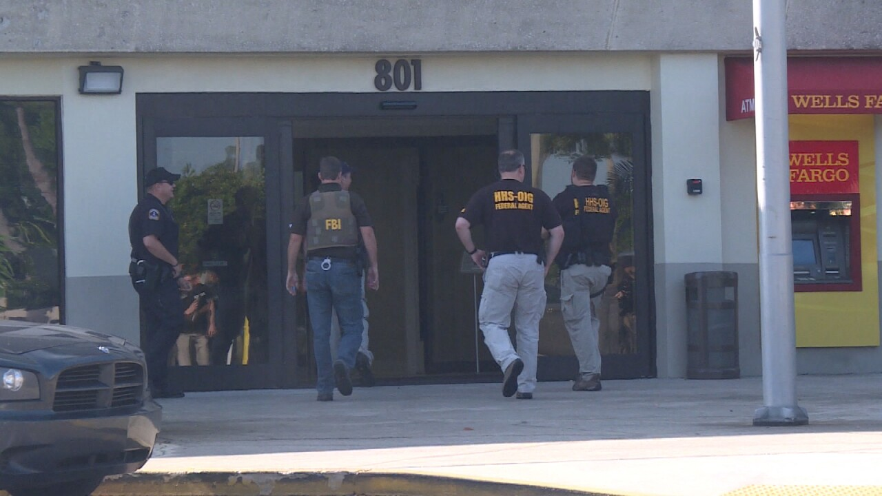 Federal agents execute a search warrant at 801 W. Bay in Largo