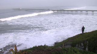 High surf pounding beaches, closes OB Pier