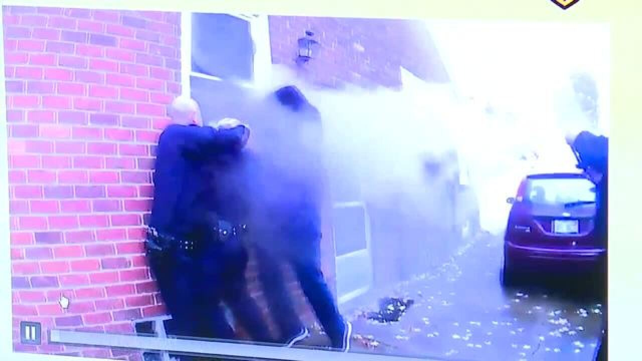 Dearborn cops rescue woman from burning home