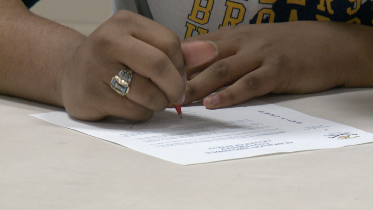 Trio of Western Branch High School football players sign college scholarships