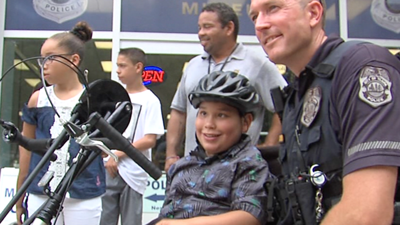 Tampa Police Department surprises boy with Spina Bifida with a custom-made tricycle