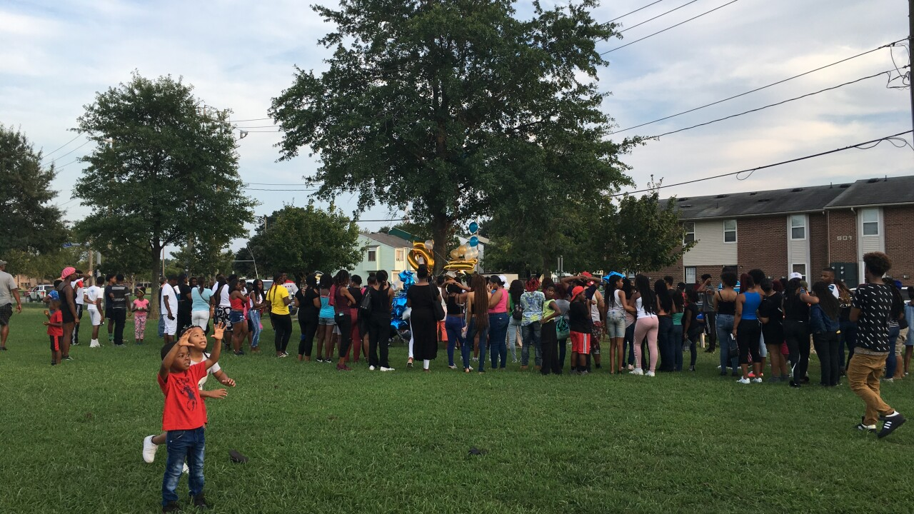 Community holds vigil for 15-year-old shot and killed in Broad Creekneighborhood