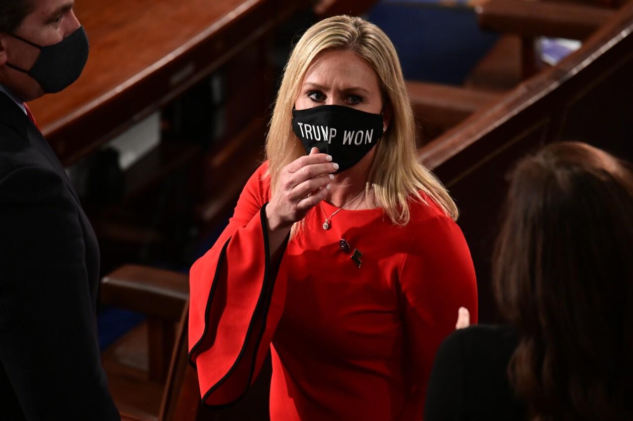 U.S. Rep. Marjorie Taylor Greene wearing 'Trump Won' mask