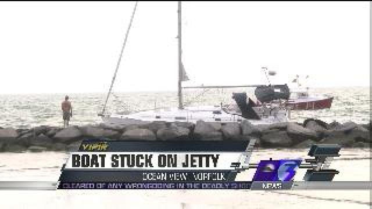 Video: Boat stuck on jetty in Norfolk during storm