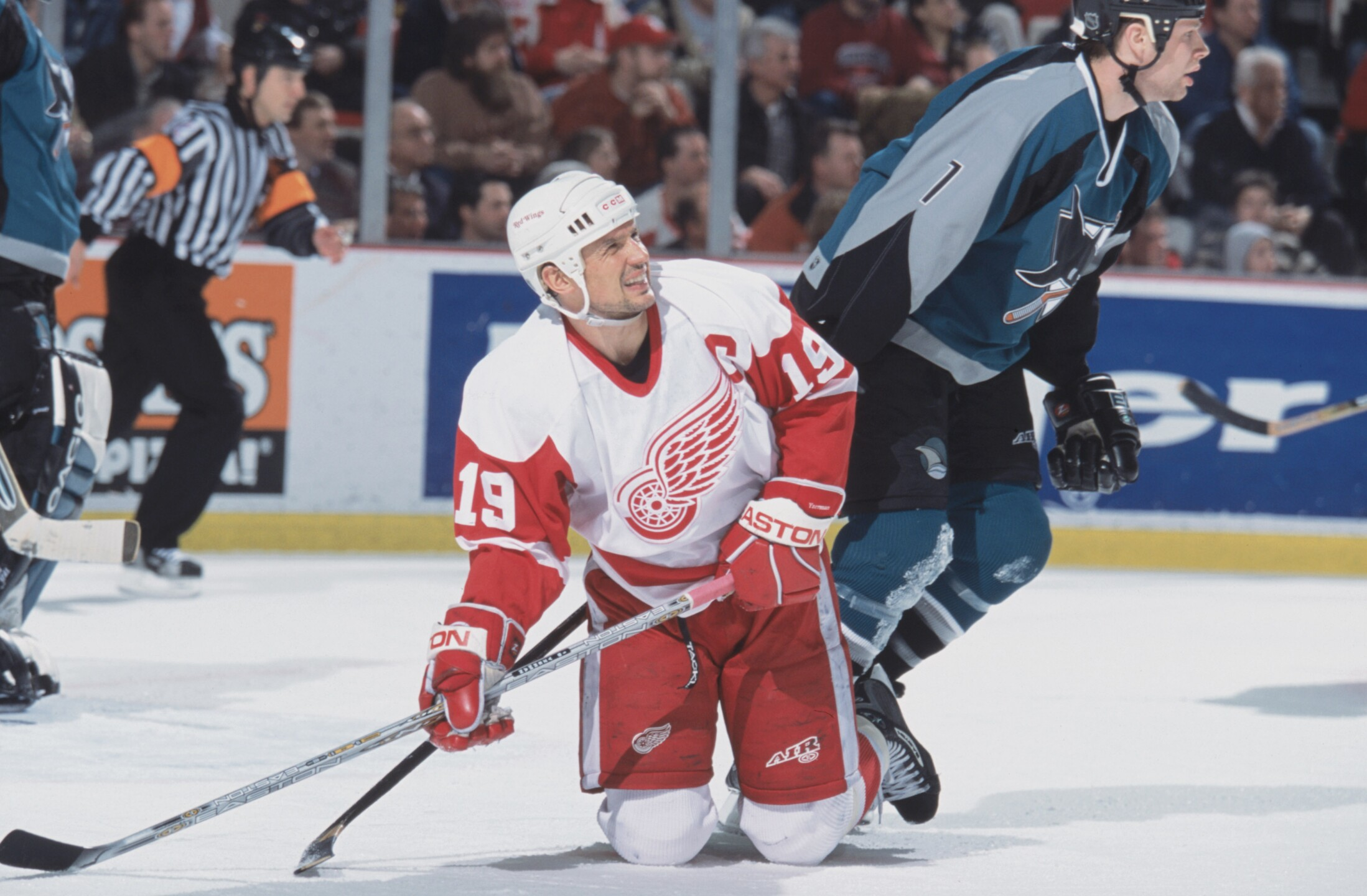 Steve Yzerman grimaces while on his knees