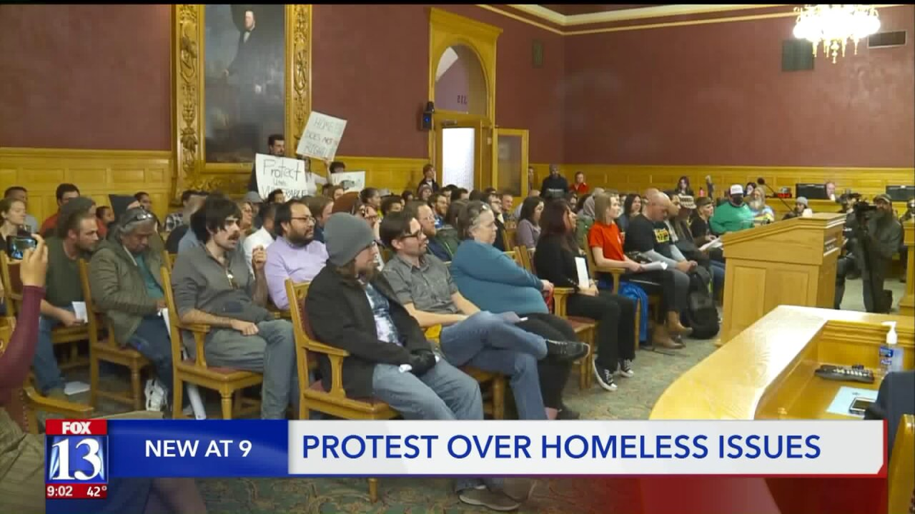City council meeting halted by protesters over Road Home closure