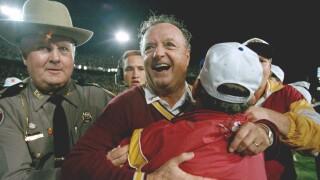 Florida State Seminoles head coach Bobby Bowden hugged after beating Nebraska in Orange Bowl to win 1993 national championship
