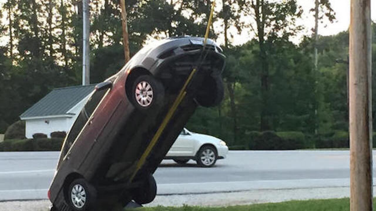 GPS tells driver to turn around; car ends up almost vertical