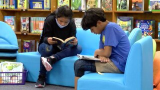 Children reading at Warfield Elementary School