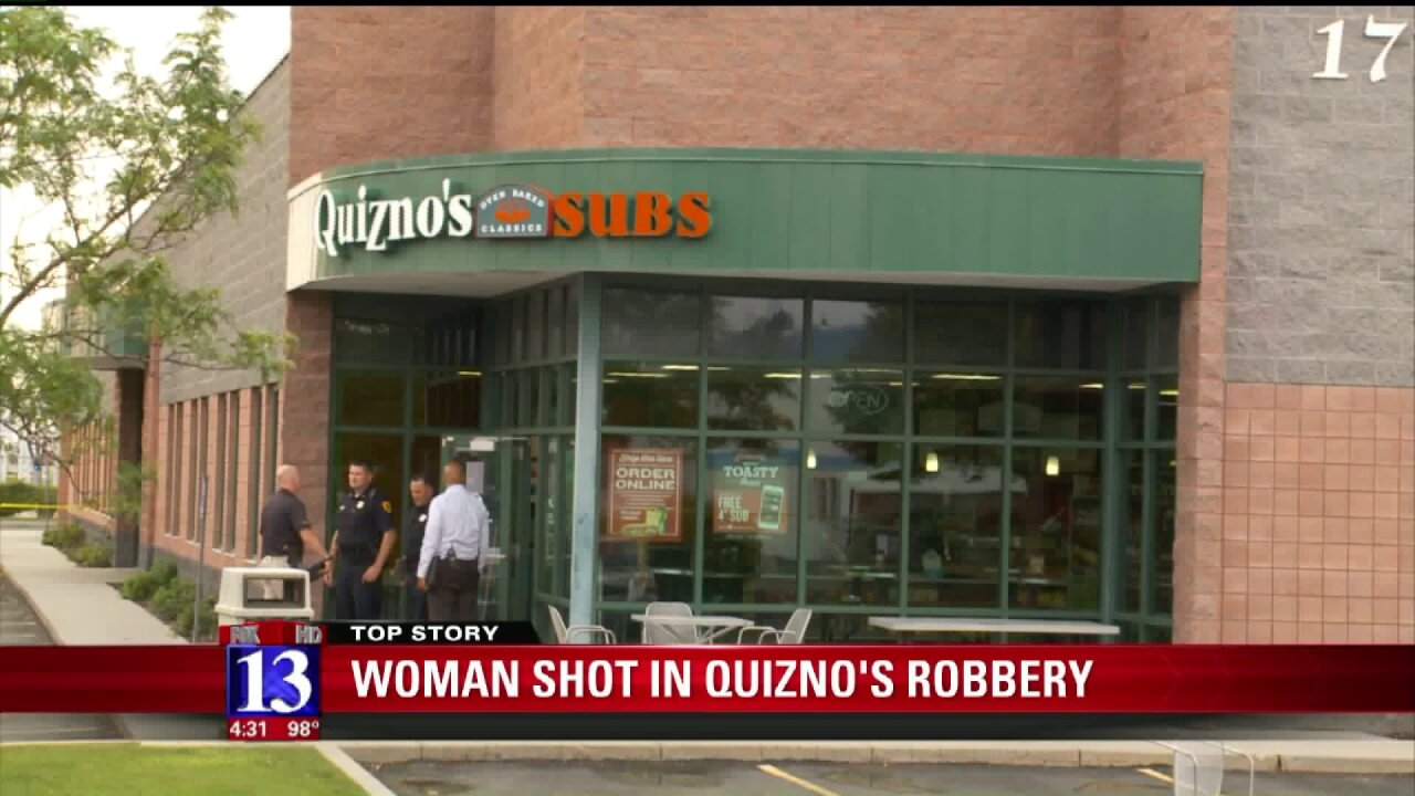 Woman in serious condition after Quiznos employee shoots suspect during armed robbery inSLC